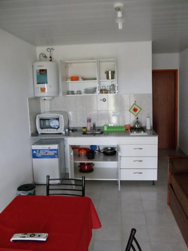 Cocina completa departamento 5 aparts la aldea for Cocina departamento